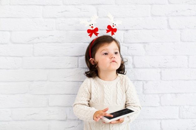 Funny little girl playing on phone