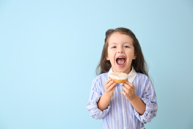 Funny little girl with donut