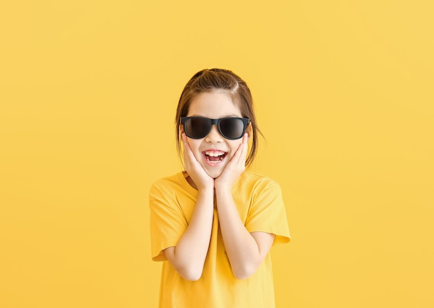 Funny little girl with sunglasses on color
