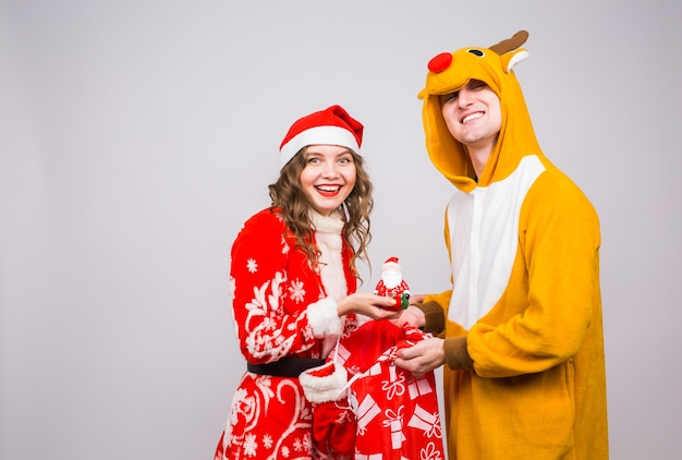 Funny man in deer costume and woman in santa claus costume