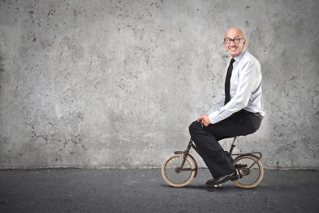 Funny man on a tiny bike