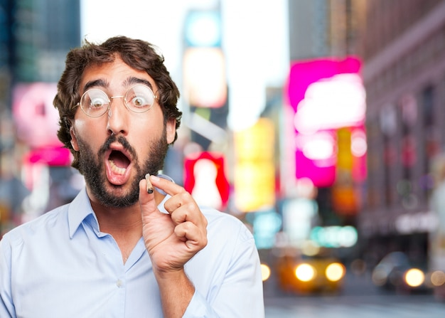 Funny man with a cigar over blurred background