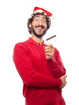 Funny man with a credit card and a santa hat