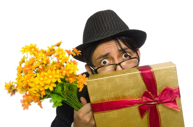 The funny man with flowers and giftbox