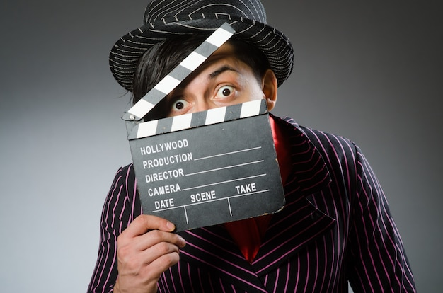 Funny man with movie board