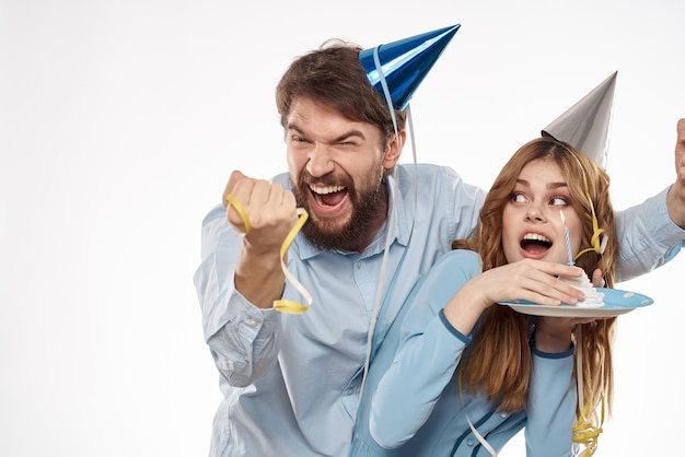 Funny man and woman holiday birthday surprise fun light background.