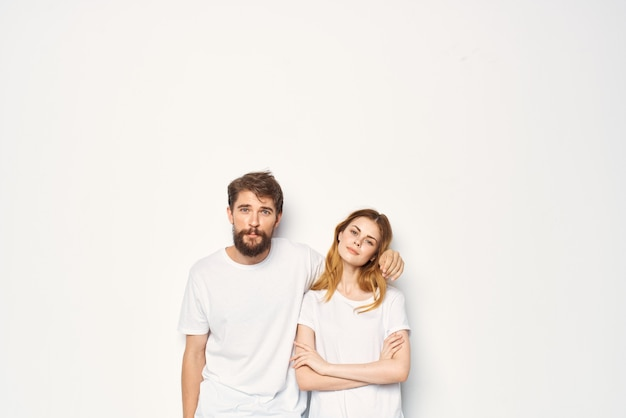 Funny man and woman in white tshirts are standing side by side friendship communication