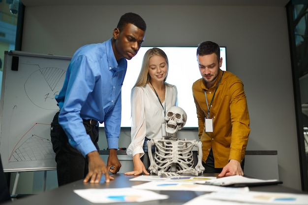 Funny managers and skeleton in it office, joke