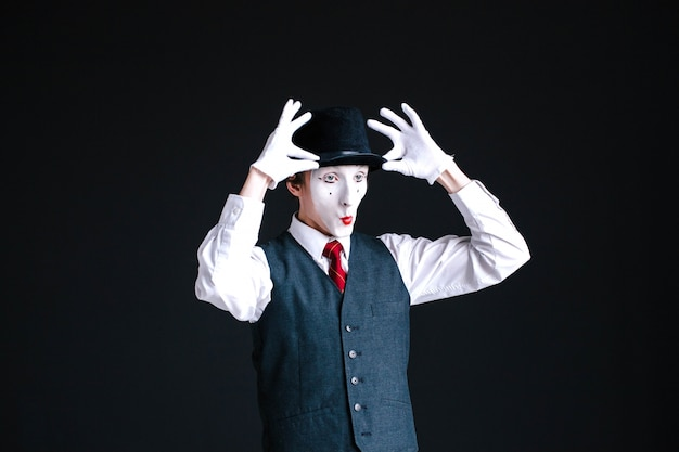 Funny mime fixes his hat