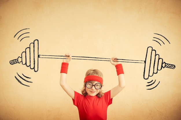 Funny nerd kid with drawn barbell. success and winner concept