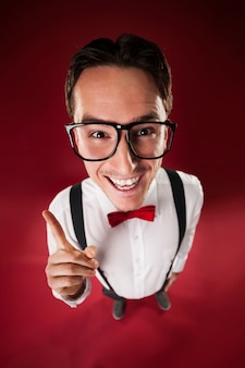 Funny nerdy man wearing big glasses