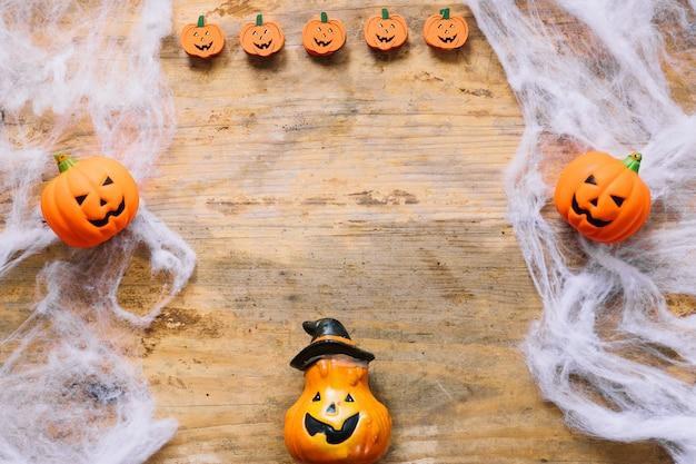 Funny plastic pumpkins and artificial web