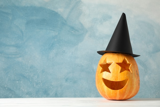 Funny pumpkin on white wooden table