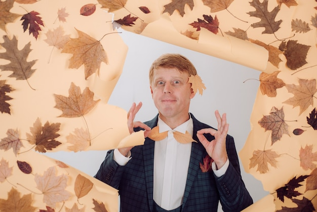 Funny redhaired man advertises your products banner for advertising of autumn clothes autumn sale