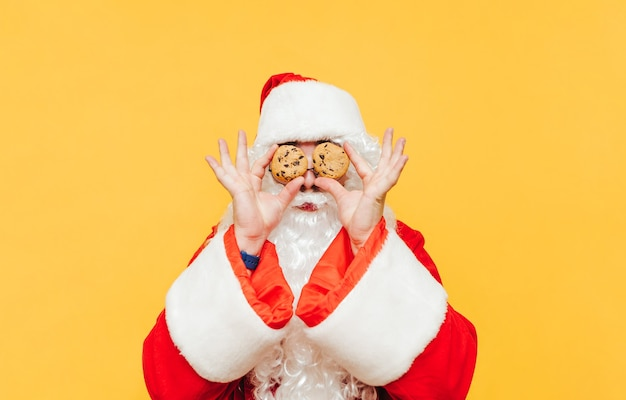 Funny santa claus with delicious cookies