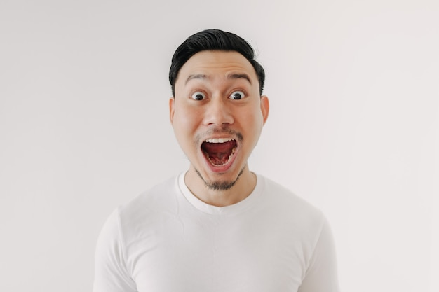 Funny shocked and surprised face of man isolated on white background