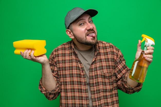 Funny slavic cleaner man holding sponge and spray cleaner