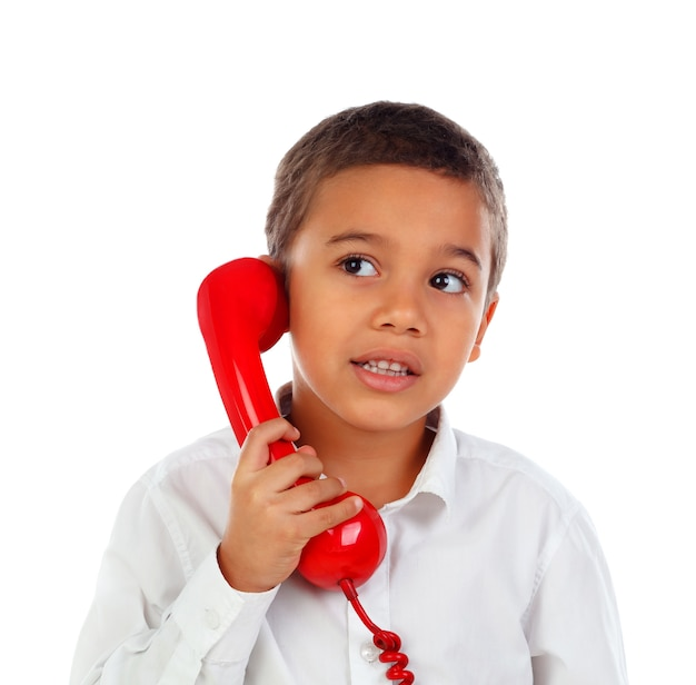 Funny small child talking on the phone