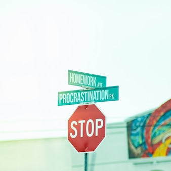 Funny street stop sign with street name writings