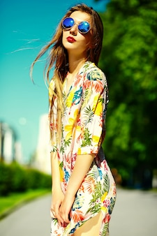 Funny  stylish sexy smiling beautiful young woman model in summer bright hipster cloth dress  in the street