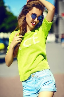 Funny  stylish sexy smiling beautiful young woman model in summer bright yellow   hipster cloth in the street