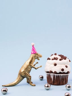 Funny toy t-rex with birthday hat