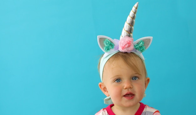 Funny unicorn little girl on blue