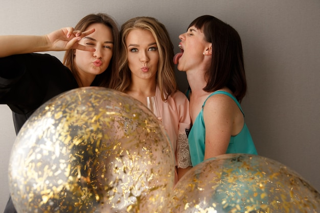 Funny women celebrating the bridal party, at home