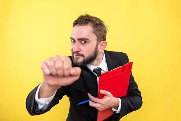 Funny young guy holding document and closing his fist