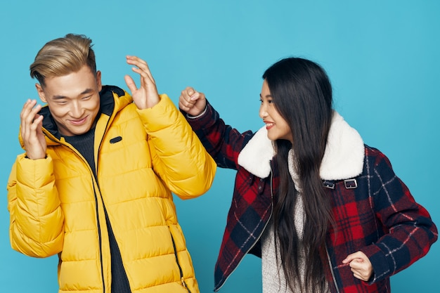 Funny young people in fashionable clothes laughing