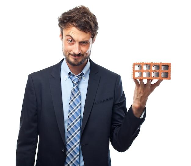 Furious work man masonry face