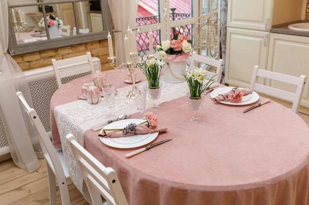 A furnished table in the living room in pink