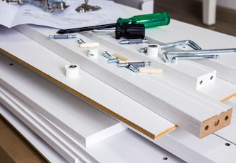 Furniture assembly concept of tool and white wood