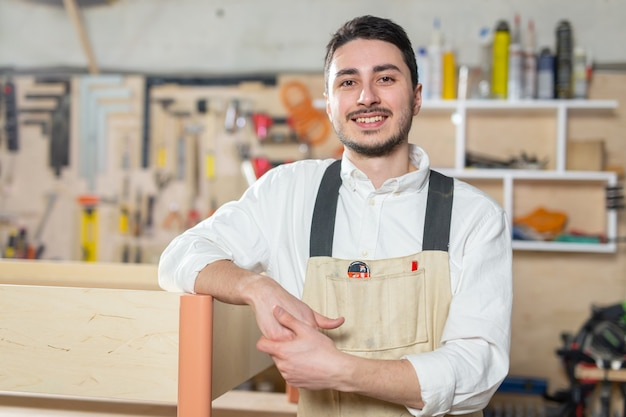 Furniture factory, small-sized companies, business concept - man worker at the furniture production