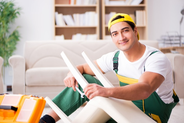Furniture repairman repairing armchair at home