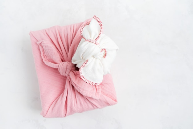 Furoshiki - asian technique of fabric wrapped gifts. the linen cloth is knotted traditionally used to transport gifts.