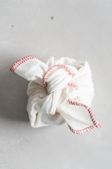 Furoshiki - asian technique of wrapping tying items for gift, easy carrying.