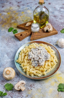 Fusilli pasta with mushrooms and chicken,top view