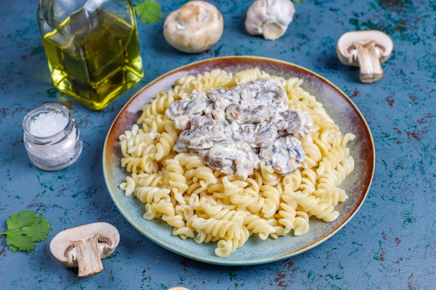 Fusilli pasta with mushrooms and chicken, top view