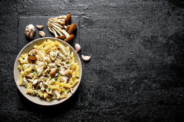 Fusilli pasta with mushrooms and garlic.