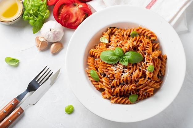 Fusilli pasta with tomato sauce.