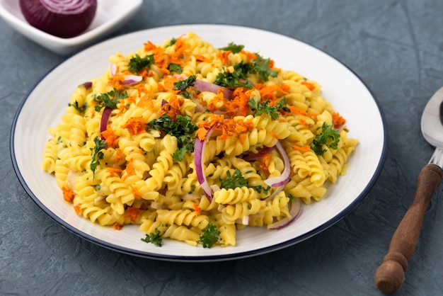 Fusilli with vegetables in herb sauce