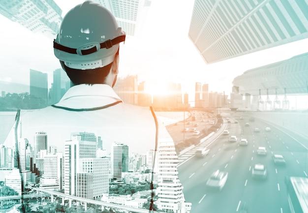 Концепция проекта строительства будущего здания с графическим дизайном двойной экспозиции. инженер-строитель, архитектор или рабочий-строитель, работающий с современной технологией гражданского оборудования.