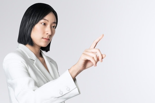 Futuristic digital presentation by an asian businesswoman