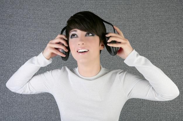 Futuristic fashion woman hearing music headphones