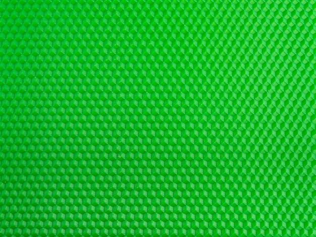 Futuristic surface. bright green geometric honeycomb background. template.