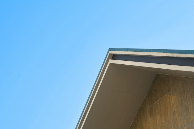 Gable roof, triangle on clear blue sky