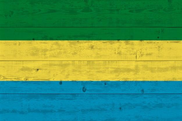 Gabon flag painted on old wood plank