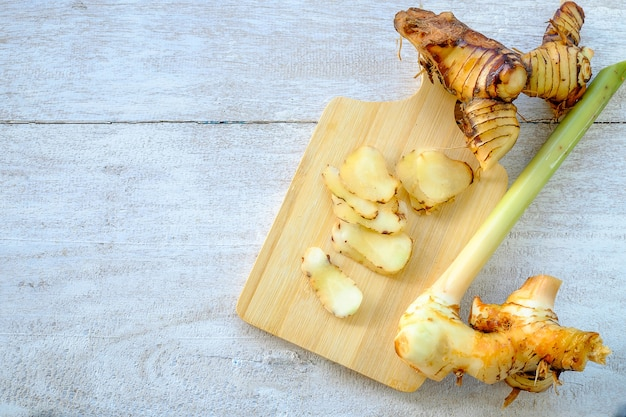 Galangal on a wooden cutting board