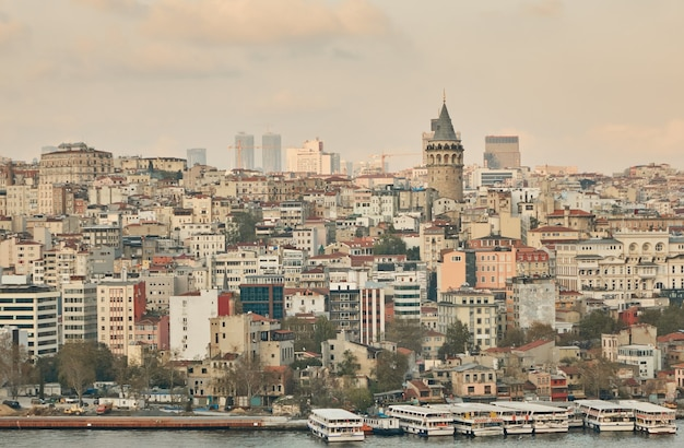 The galata tower, the city of istanbul and the embankment with the passenger ships. turkey